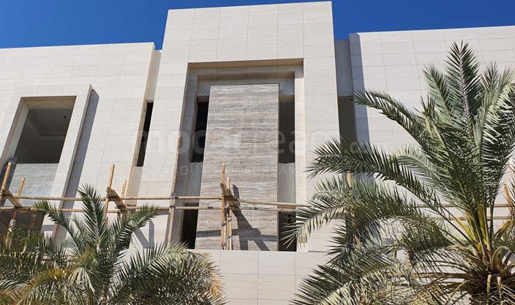 Beige limestone cladding in the Gulf region
